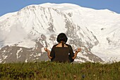 France, Saint-Gervais, Meditation in front of the Mont Blanc.