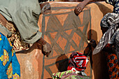 Burkina Faso, village of Tangasomogo, Cassena women create beautiful abstract frescoes that decorate the walls of their mud huts, situated in a round formation