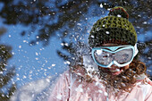 France, Alps, portrait of a teenage girl, snow ball in her face