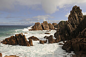 Strong waves at Cape Woolamai's Pinnacles, pink granite sculptured by rain and see, Phillip Island, Victoria, Australia