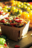 Canada, Quebec Province, Montreal, Jean Talon market, hot red and yellow peppers in a little basket
