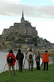 France, Manche, Le Mont Saint Michel, Japanese tourists at Mont Saint Michel