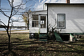 Side of House With Bare Tree in Yard, Grafton, Illinois, USA