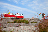 Small Group of People Looking at Stranded Fishing Boat, Oland, Sweden