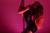 Woman in Sparkling Dress  Pole Dancing