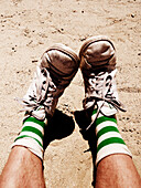 Sneakers and Socks With Green Stripes