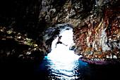 Male Rock Climber in Sea Cave, Mallorca, Spain