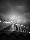 Circus Tent and String of Lights Against Dramatic Sky