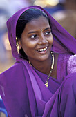 Indian woman wearing purple Sari. Goa, India.