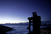 Snowboarder enjoying panoramic view in twilight, Chandolin, Anniviers, Valais, Switzerland