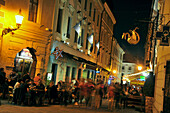 People in the alleys of the old town at night, Bratislava, Slovakia, Europe