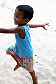 Thai boy at the beach of Koh Ra eco lodge, Koh Ra, Andaman Sea, Thailand