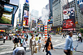 Times Square and Broadway and people with motion blur, Manhattan, New York, USA
