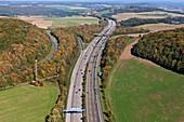 Aerial view of motorway A 48 in autumn, Eifel, Rhineland Palatinate, Germany, Europe