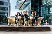 Tourists standing next to bear sculptures at Neues Kranzler Eck, Kurfuerstendamm, Charlottenburg, Berlin, Germany