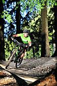 Mountain biker passing a curve in a bike park, Samerberg, Upper Bavaria, Germany