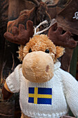 Souvenir cuddly toy moose wearing a pullover with Swedish flag, Stockholm, Stockholm, Sweden