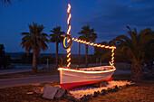 Lighted boat at access road to Son Serra de Marina, Mallorca, Balearic Islands, Spain, Europe