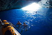 People swimming in the Blue Grotto, Cabrera island, Balearic Islands, Spain, Europe