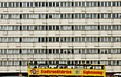Bus with tourists in front of a Plattenbau, Alexanderplatz, Mitte, Berlin, Germany, Europe