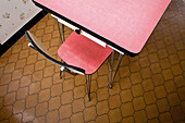 Empty chair at table, overhead view