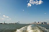Manhattan Skyline and Statue of Liberty seen from Staten Island Ferry, Manhattan, New York, USA, America