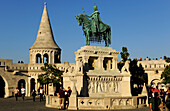 People at monument of Saint Stephen and Fisherman's Bastion, Budapest, Hungary, Europe