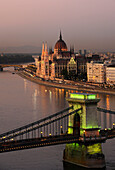 View of Danube river, Chain Bridge and House of Parliament in the evening, Budapest, Hungary, Europe