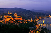 Castle hill with illuminated castle in the evening, Budapest, Hungary, Europe