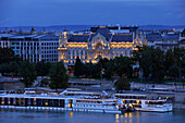 Steam ship on Danube river and Gresham Palace in the evening, Budapest, Hungary, Europe
