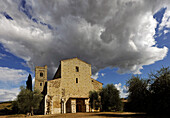 St. Antimo Abbey under clouded sky, Province of Siena, Tuscany, Italy, Europe