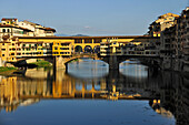 The bridge Ponte Vecchio above Arno river in the sunlight, Florence, Tuscany, Italy, Europe