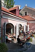 People seated outdoors at restaurant on Toompea hill, Tallinn, Harjumaa, Estonia