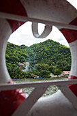 Chinese temple with dragon staircase along River Kwai Noi seen through lifering of river cruise ship RV River Kwai (Cruise Asia Ltd.), near Kanchanaburi, Thailand