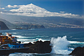 Breakers at the village of El Pris, coastline, valley of Orotava, view to Teide 3718m, the islands  landmark, country high point, volcanic mountain, Tenerife, Canary Islands, Spain, Europe