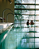 Couple in an indoor pool looking out of a picture window,  Vigiljoch, Lana, Trentino-Alto Adige, South Tyrol, Italy
