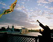 Flying a kite on Moskva bridge at sunset, view on Kremlin, Moscow, Russia, Europe