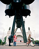 Visitors underneath booster rocket at All Russia Exibition Centre VVC, Moscow, Russia, Europe