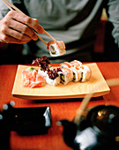 Ukrainian Sushi Roll coated in bacon, restaurant near  metro station Novoslobotskaya, Moscow, Russia, Europe