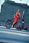 Woman cycling on an e-bike, bike tour, Schlossplatz, Art Museum, Stuttgart, Baden-Wurttemberg, Germany
