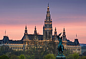 Statue of archduke Charles and town hall in the afterglow, Vienna, Austria, Europe