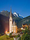 Illuminated church at night, Hohe Tauern National Park, Grossglockner, Carinthia, Austria, Europe