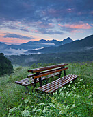 Bench in the middle of a field, Ampezzo, Friuli, Italy