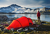 Person with tent in front of lake Schwarzhornsee and Hochalmspitze, Hohe Tauern National Park, Carinthia, Austria, Europe