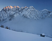 View of hut in the snow, Puster valley, Bannberg and Spitzkofel at sunset, Lienzer Dolomiten, Tyrol, Austria, Europe