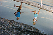 Couple jogging along lakeshore, lake Starnberg, Bavaria, Germany