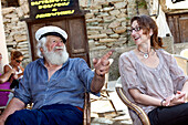 Old sea salt chats with a visitor, village of Centuri Port, Cap Course, Corsica, France