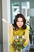 Woman looking at a bowl of salad