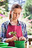 Girl gardening and thinking