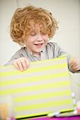Boy opening his birthday present